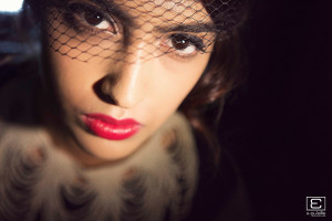 film noir themed pre wedding shoot portait image of Suhela with bright red lipstick